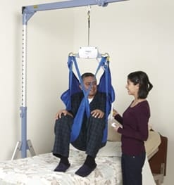 man with disability being transferred in a patient lift